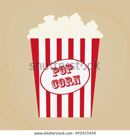 Spilled popcorn on a brow background, cinema, movies and entertainment concept