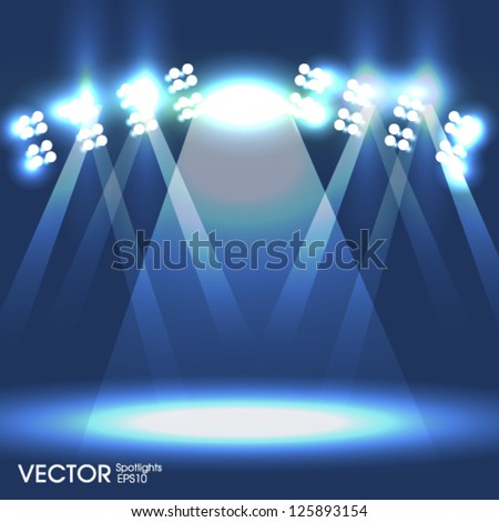 Spotlights with rays - stock vector