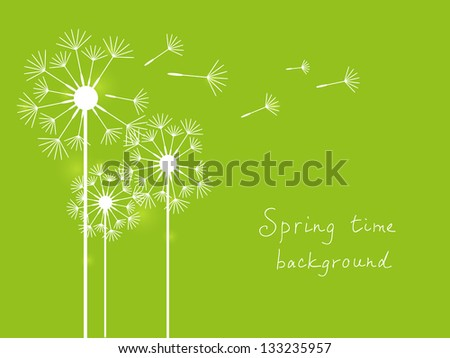 Spring background with dandelions on green