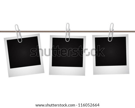 Square blank photos hung on a string with paperclips isolated on white