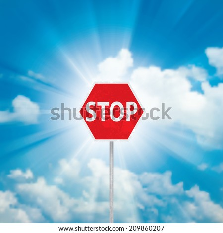 Stop Sign and blue sky with clouds and sun ray