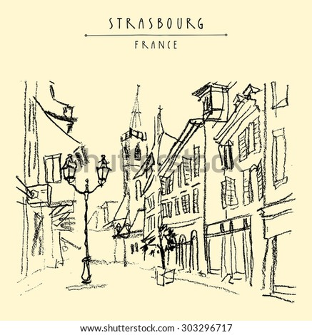 "Strasbourg, France. Street in old town. Historical buildings, church, shops, lights. Bold freehand drawing. Black charcoal on paper. Vector travel sketchy postcard, ""Strasbourg, France"" hand lettering"