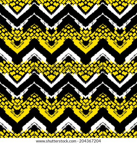 Striped hand painted vector seamless pattern with ethnic and tribal motifs, zigzag lines and brushstrokes in bright yellow, black and white colors for summer fall fashion - stock vector