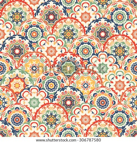 Stylish  ornamental seamless pattern, trendy red-blue -yellow colored design. Can be used for wallpaper, surface textures, textile etc.