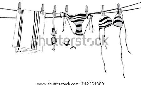 Swimwear hanging on a clothesline.