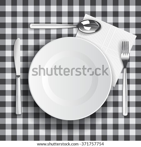 Table appointments.  Template with empty plate, fork, knife and spoon on retro tablecloth.