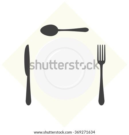 table set - a spoon, a fork, a knife and a plate