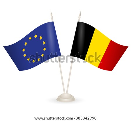 Table stand with flags of EU and Belgia. Symbolizing the cooperation between the two countries. flag icons. Two flag vector. flag pole.  - stock vector