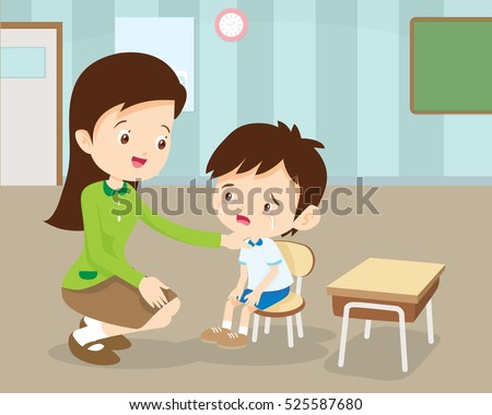 Teacher Comforting Upset Elementary School Pupil.teacher comforting crying preschool boy.
