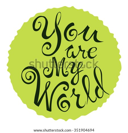 Text of You are my world, on a green circle