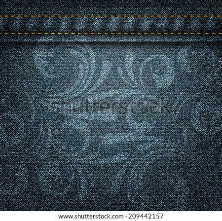 Texture of dark jeans with floral swirly print