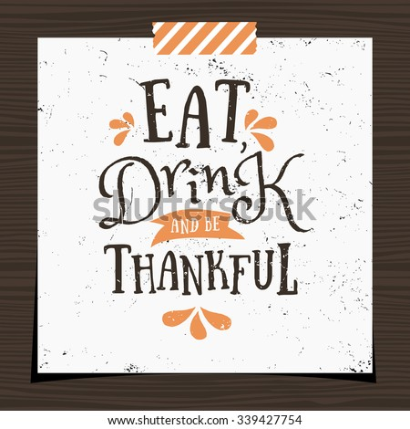 """Thanksgiving typographic design greeting card template. """"Eat, Drink and Be Thankful"""" in black and orange on white background. Thanksgiving Day card with a strip of washi tape on dark wood background. - stock vector"""