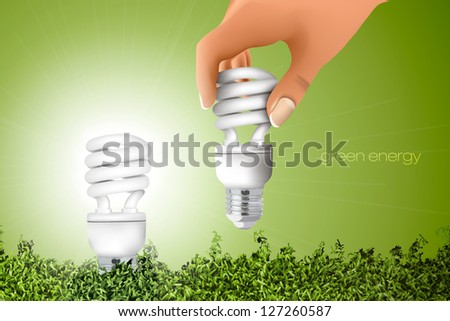 the concept of clean energy. hand holding energy saving bulb