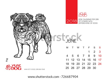 The desktop calendar page for 2018 with the image of a dog, a symbol of the Chinese horoscope for 2018.