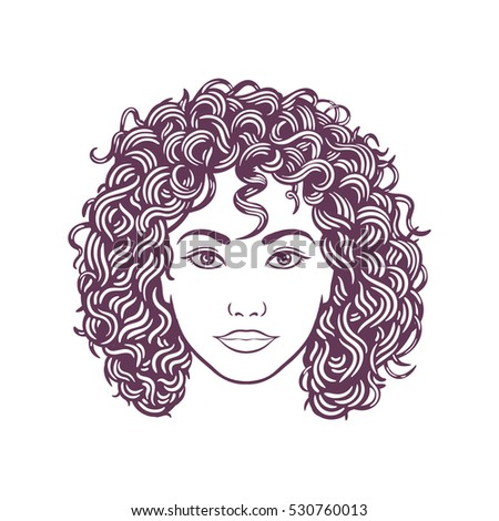 The face of a girl with long curly hair.