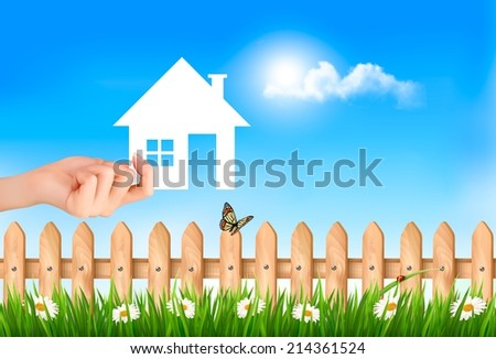 The house in hand on green natural background. Vector.  - stock vector