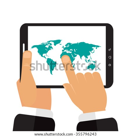The tablet in the hands of a map of the earth