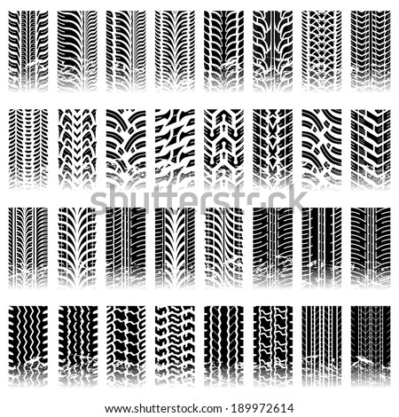 Thirty two piece set of tileable grunge tire track patterns - stock vector