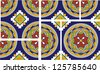 This talavera inspired spanish tile has intersecting circles with intricate floral patterns and a navajo like cross motif. This file includes 2 full square tiles, 2 half tiles and the quartered tile. - stock photo