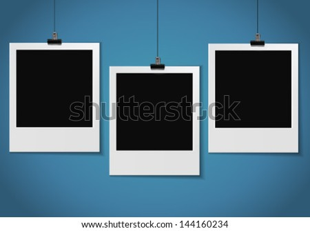 three blank photo pinned on blue wall - stock vector