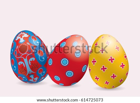 Three bright colorful ornamental Easter eggs with shadow on light pink background