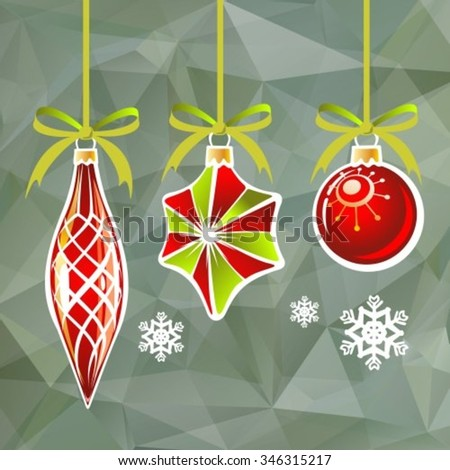 Three Christmas toys on a gray polygonal background.