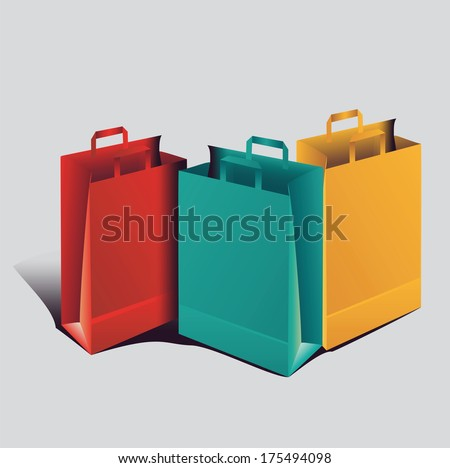 three colored paper shopping bags