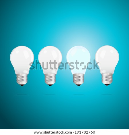 Three switched off light bulbs and one lightbulb alight