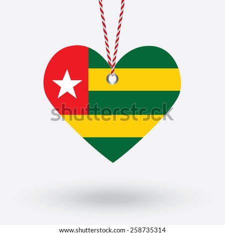 Togo flag in the shape of a heart with hang tags - stock vector
