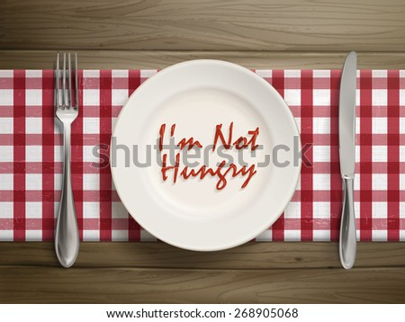 top view of I am not hungry written by ketchup on a plate over wooden table - stock vector