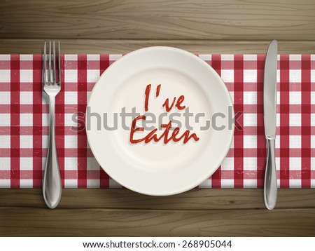 top view of I have eaten written by ketchup on a plate over wooden table - stock vector