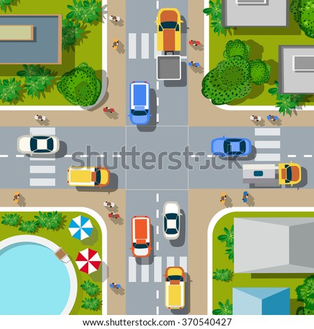 Top view of the city. Urban crossroads with cars and houses, pedestrians.