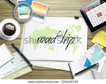 top view of travel items on wooden table with road trip written on paper - stock vector