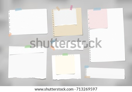 Torn ruled, blank, squared note, notebook, copybook paper strips, sheets stuck with colorful sticky tape on gray background.