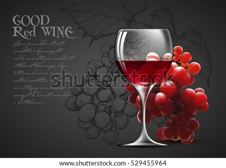 transparent glass of red wine and a branch of grapes