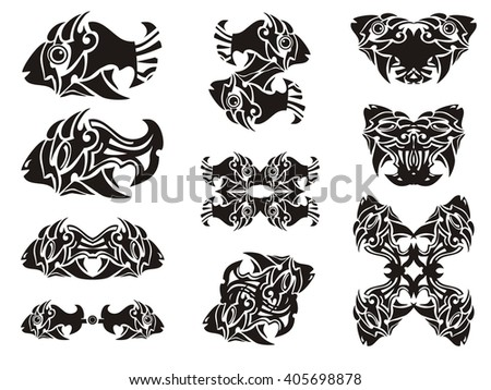 Tribal fish symbols. Decorative double symbols of fishes isolated on a white background - stock vector