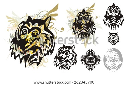 Tribal monster wolf head with splashes and the head of the monster. Set of the heads of the monster for a carnival. Tribal grunge wolf head with floral splashes and blood drops - stock vector