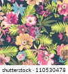 tropical flower pattern on blue background - stock photo