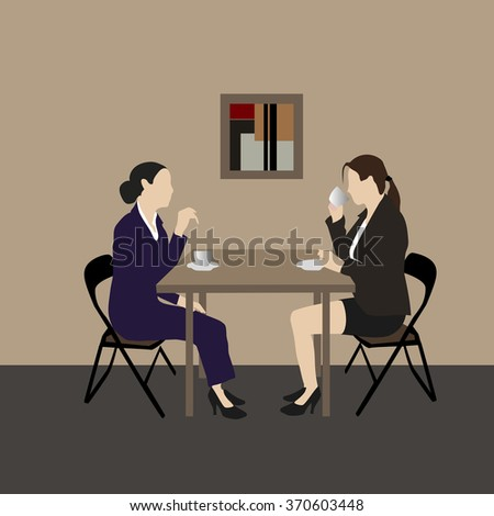 Two business woman in a cafe talking