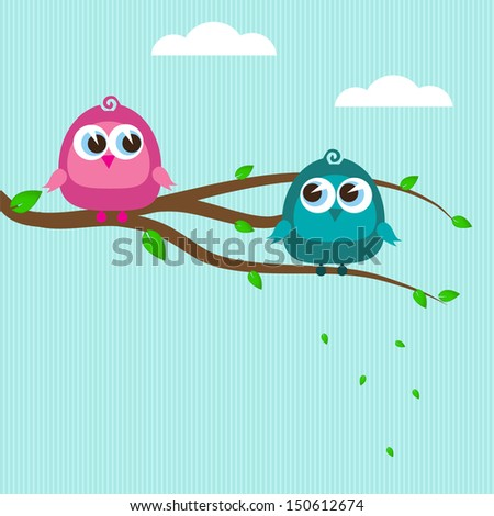 Two cute birds on the tree branch