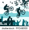 two cyclists perform a leap over the crowd of spectators - stock vector