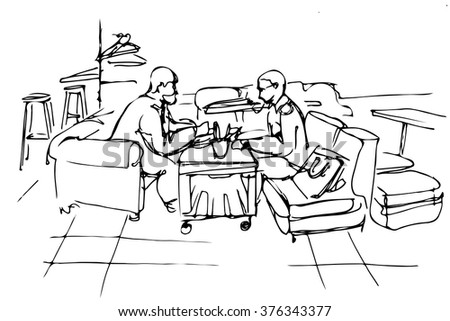 two friends on a couch in a cafe