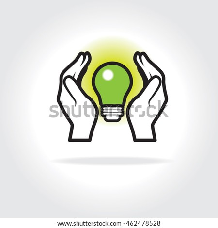 Two hands carefully cupping a light bulb, concept for green energy, conservation and using alternative sources.