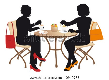 Two women at a small table drinking tea.