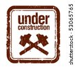 under construction grunge rubber stamp with two hammers - stock vector