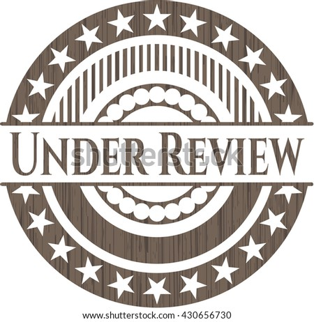 Under Review realistic wooden emblem - stock vector