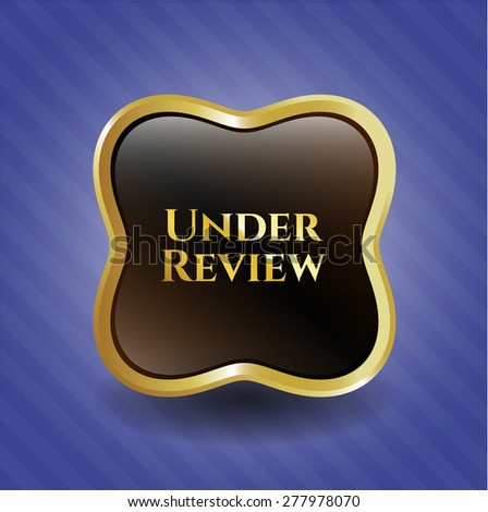 Under review shiny badge - stock vector