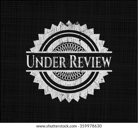 Under Review written on a blackboard - stock vector