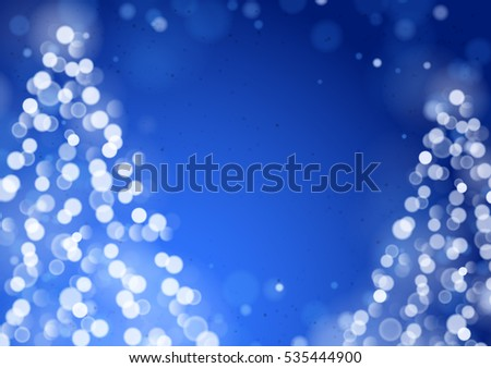Unfocused Blurred Lights and Two Christmas Trees on the Blue Background with an Empty Space for a Text Message