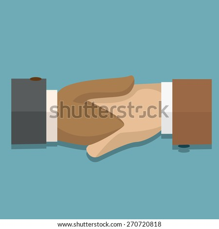 Unique Perspectives of two businessman shaking hands in making a deal or an agreement.